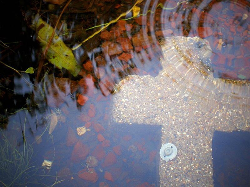 cross in water pond